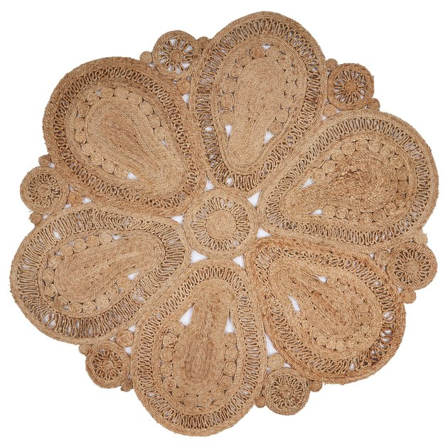 Circulare natural jute rug featuring doily-like design