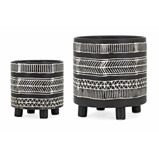 black and white pattern pots with legs