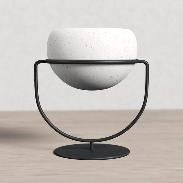 white planter in black stand