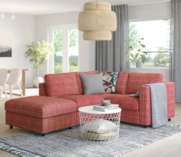living room with coral couch and white coffee table