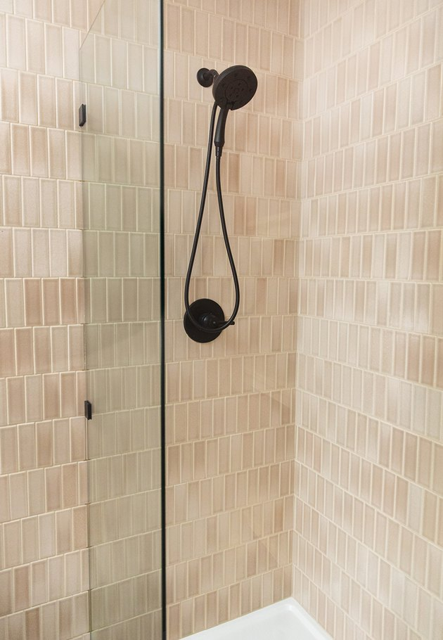 nude pink subway tile shower idea with matte black shower