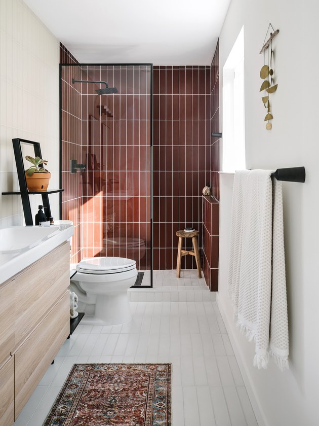 white bathroom with burgundy subway tile shower idea in the shower