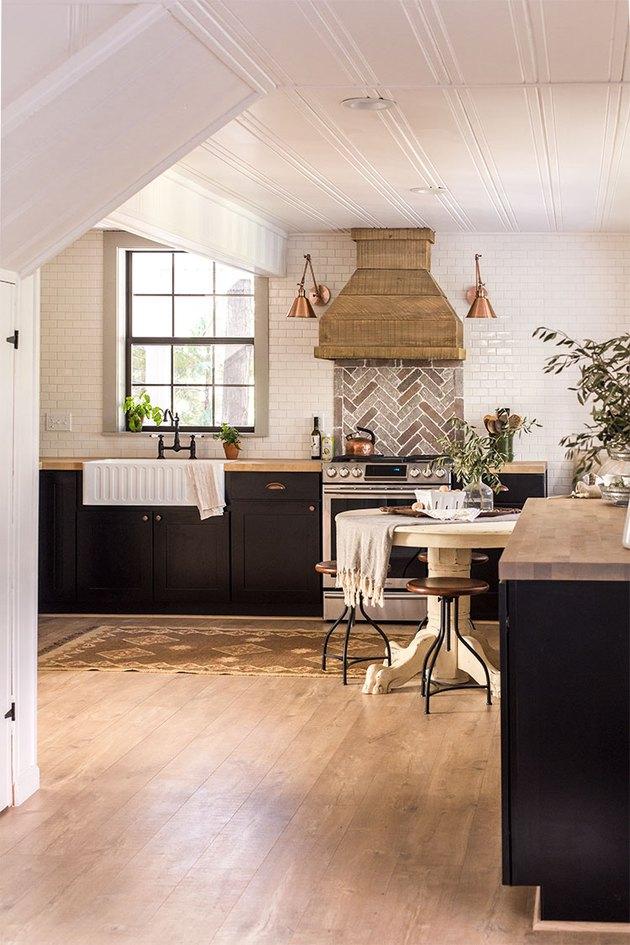 herringbone brick backsplash in navy and white kitchen