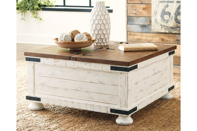 oversized coffee table with wood plank tabletop and white finish with heavy distressing