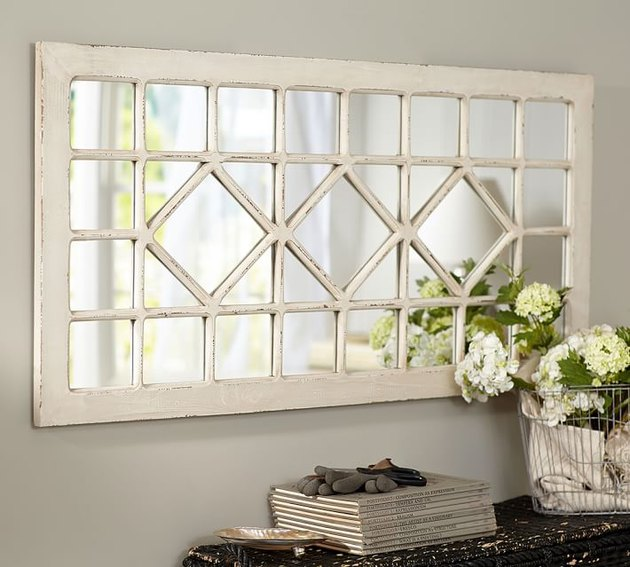 antique farmhouse mirror with trellis design and distressed finish