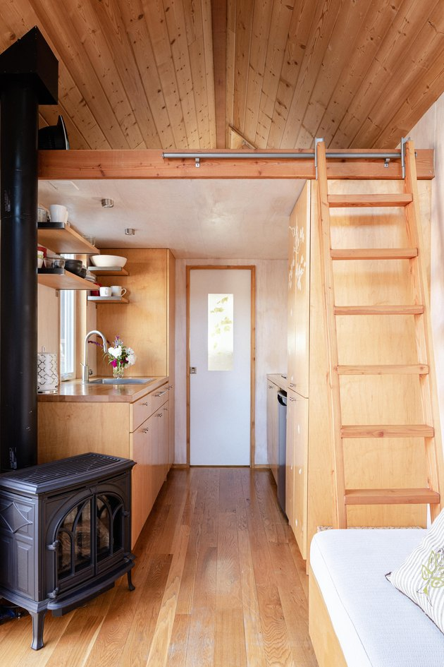 Sol Haus Design tiny home living area with ladder to bed