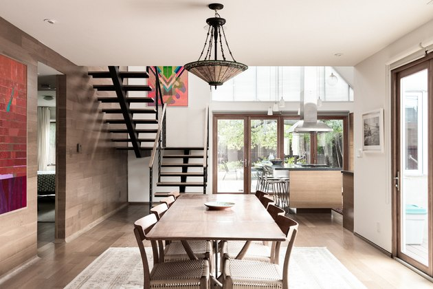 dining room space with long table and craftsman style chandelier