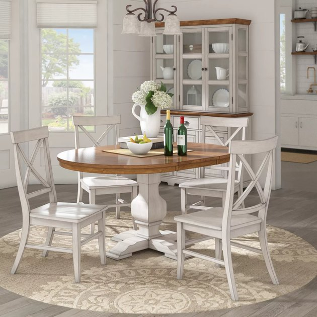 dining room space with white chairs and wood table