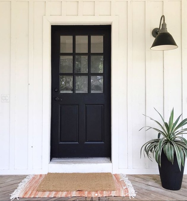 farmhouse porch idea with board and batten siding and black front door
