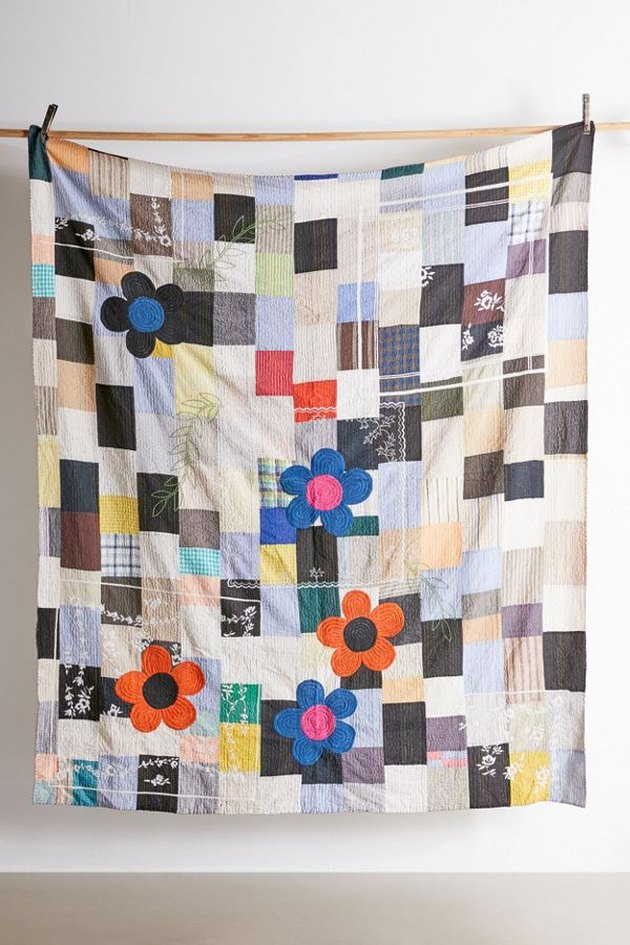 embroidered quilt with checkered pattern and flowers