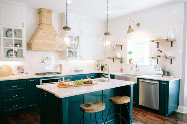 Craftsman kitchen with green cabinets and white subway tile walls