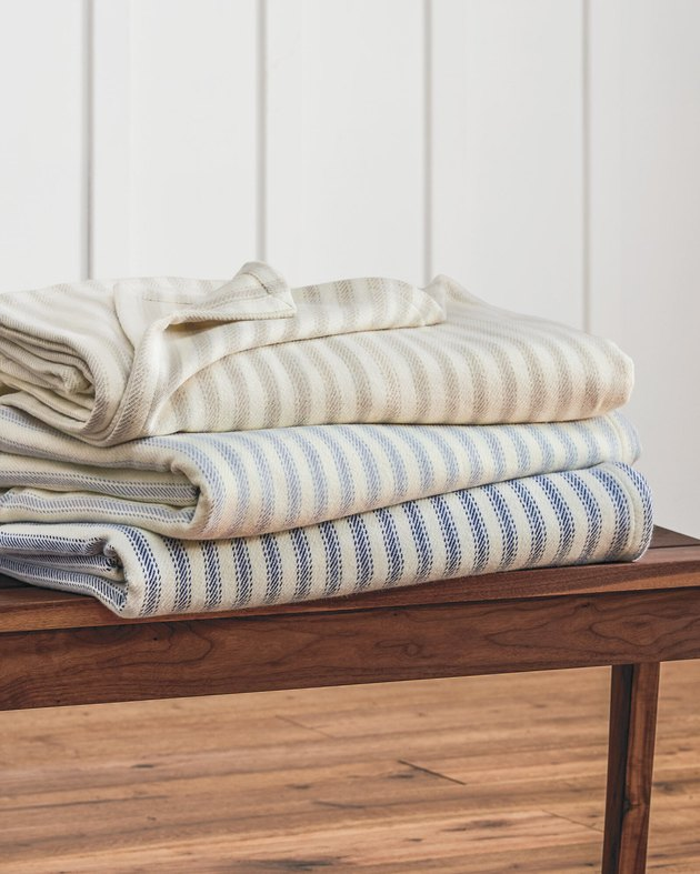 farmhouse bedding idea with ticking stripe blankets from Pendleton