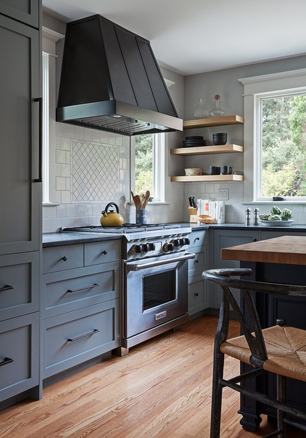Craftsman kitchen with grayish blue cabinets and tile backsplash
