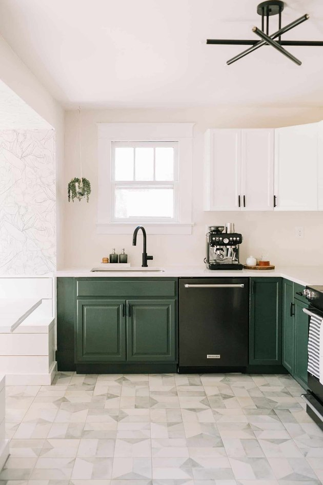 Craftsman kitchen with white and green cabinets and patterned flooing