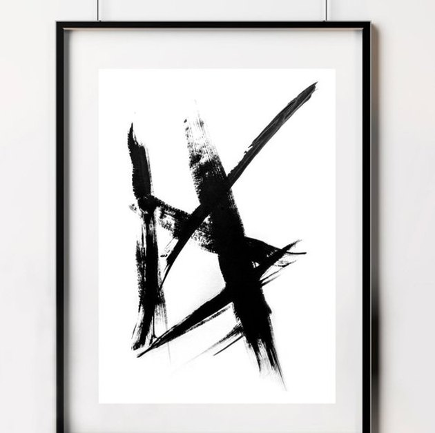 Abstract print of black brush strokes on white background