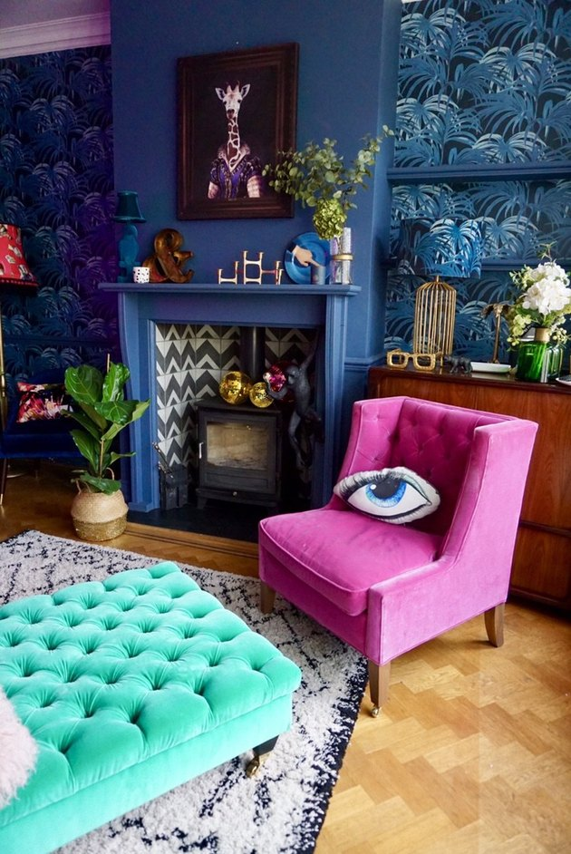 Colorful living room with blue walls and blue fireplace surround