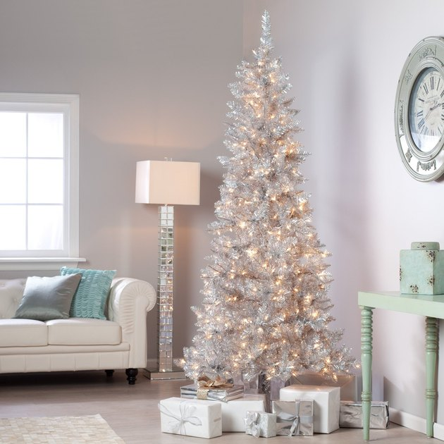 silver Christmas tree in bright living room