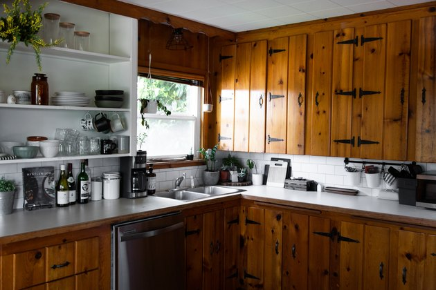 kitchen space with open shelves and wood cabinets