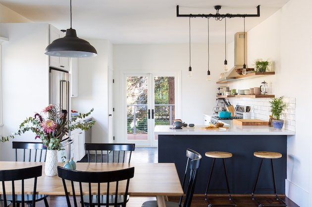 Craftsman kitchen with white and blue cabinets and white subway tile backsplash