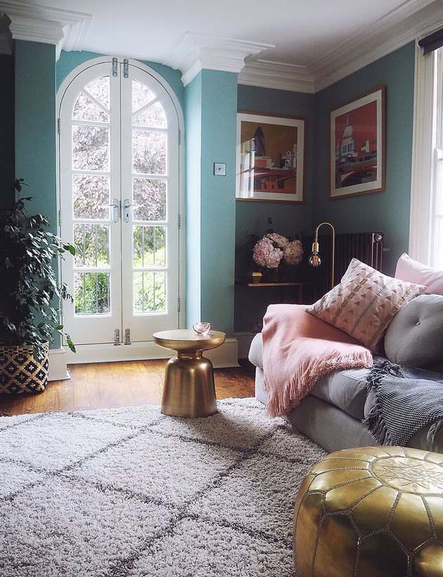 Blue living room with arched French doors and vintage accessories