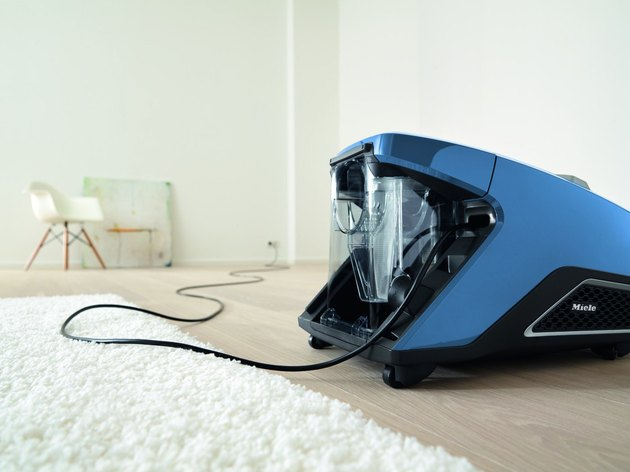 focus on vacuum and cord in white room