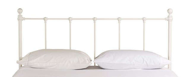 White metal headboard with vertical posts