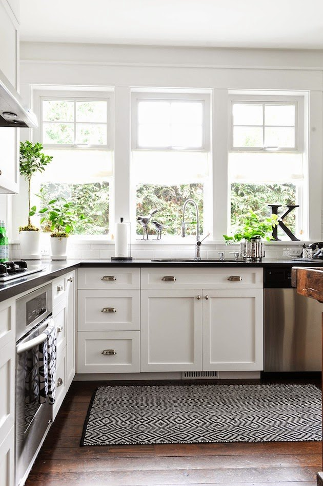 white Craftsman style kitchen with black countertops