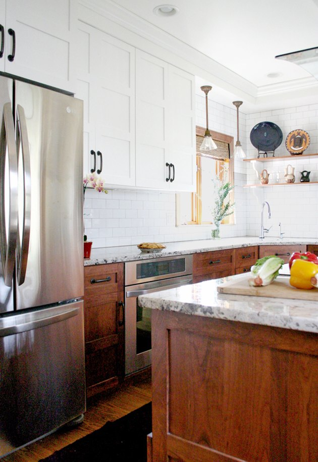 Craftsman kitchen with white upper cabinets and dark wood lower cabinets
