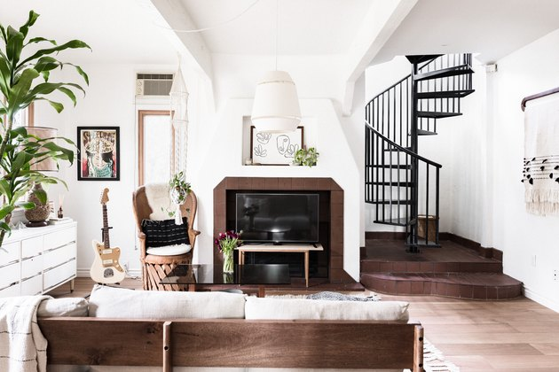 living room with hardwood floors and spiral staircase