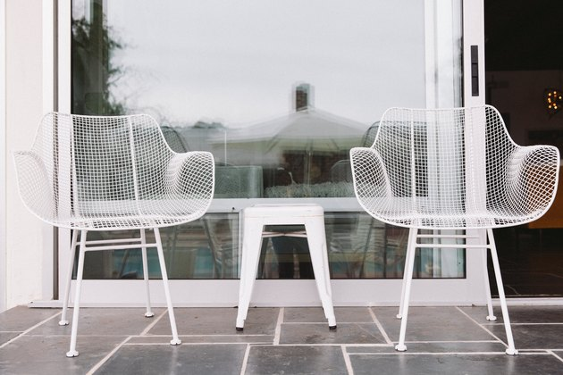 focus on two outdoor chairs on a slate patio