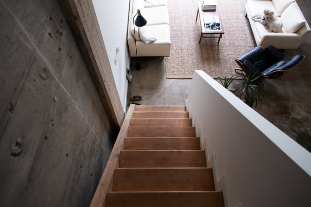 view down a wood stairway into living room
