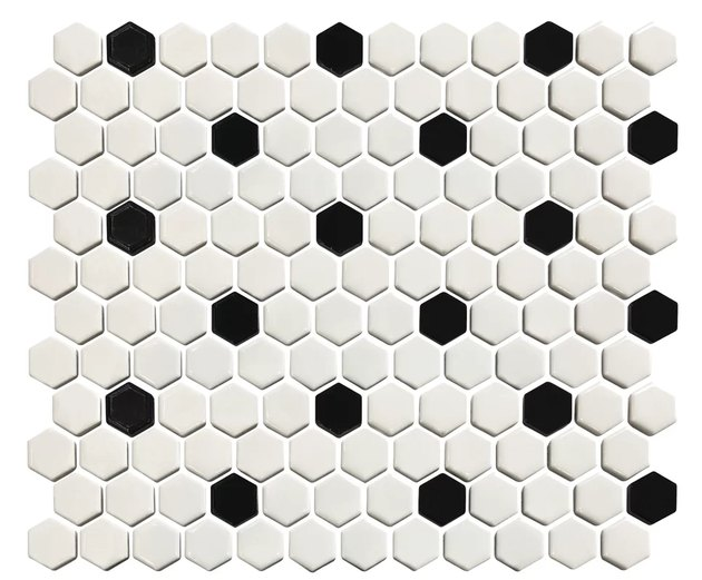 Black and white polka-dotted penny tile. White dominant