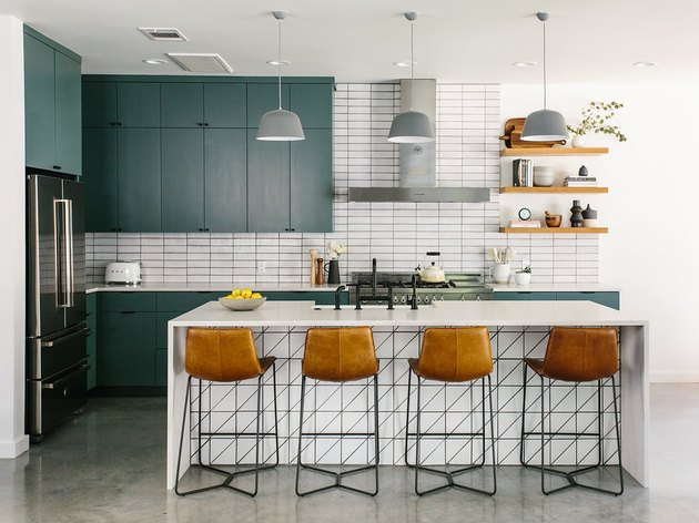 Teal kitchen idea with teal cabinets and white subway tile backsplash with midcentury decor