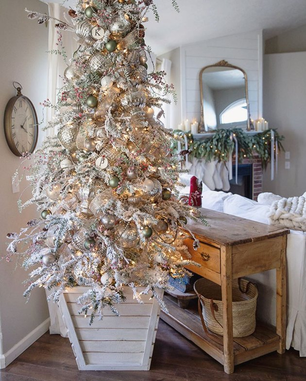 flocked farmhouse Christmas tree idea planted in wooden planter