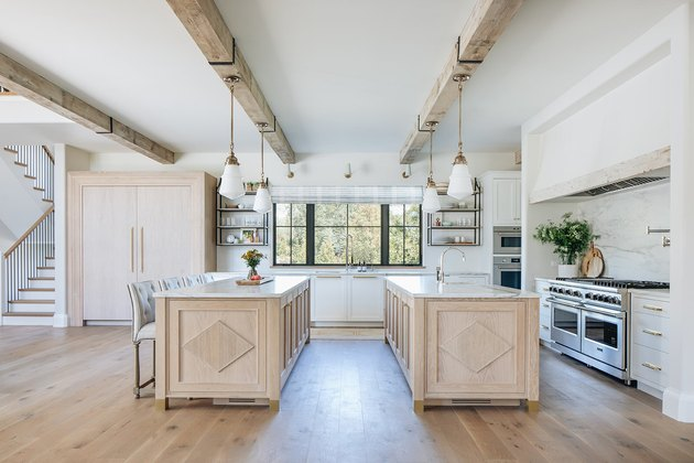 double island kitchen with farmhouse flooring idea