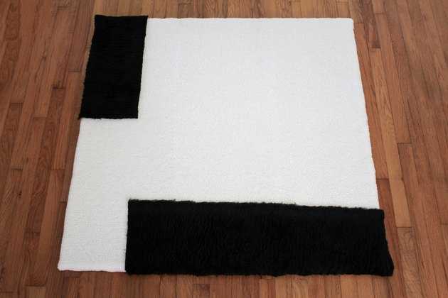 Placing black shearling fabric on top of white shearling
