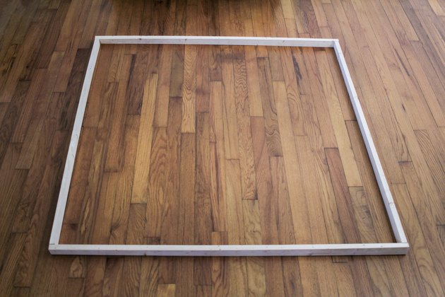 Four wood boards laid out to form a square
