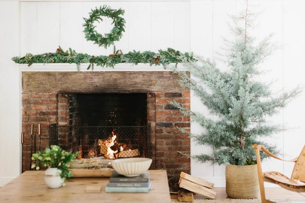 farmhouse Christmas tree idea with no decorations planted in woven basket