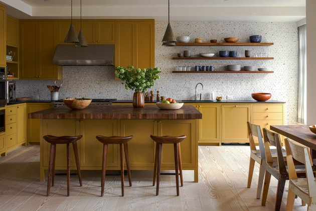 warm yellow kitchen color idea with patterned tile backsplash