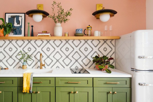 pink and olive green kitchen color idea with white countertop and patterned tile backsplash