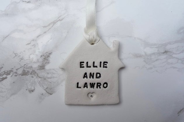 ornament with text reading ellie and lawro