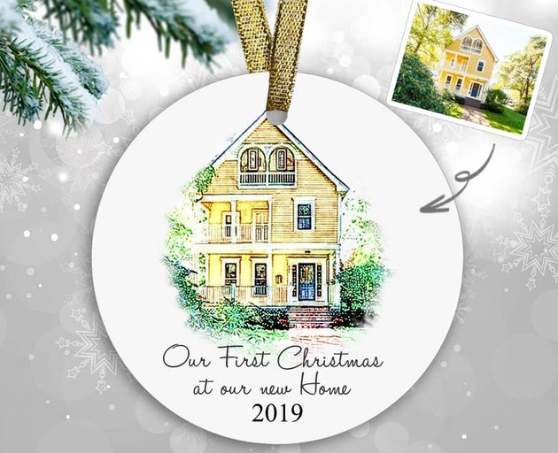 ornament with a house and text underneath
