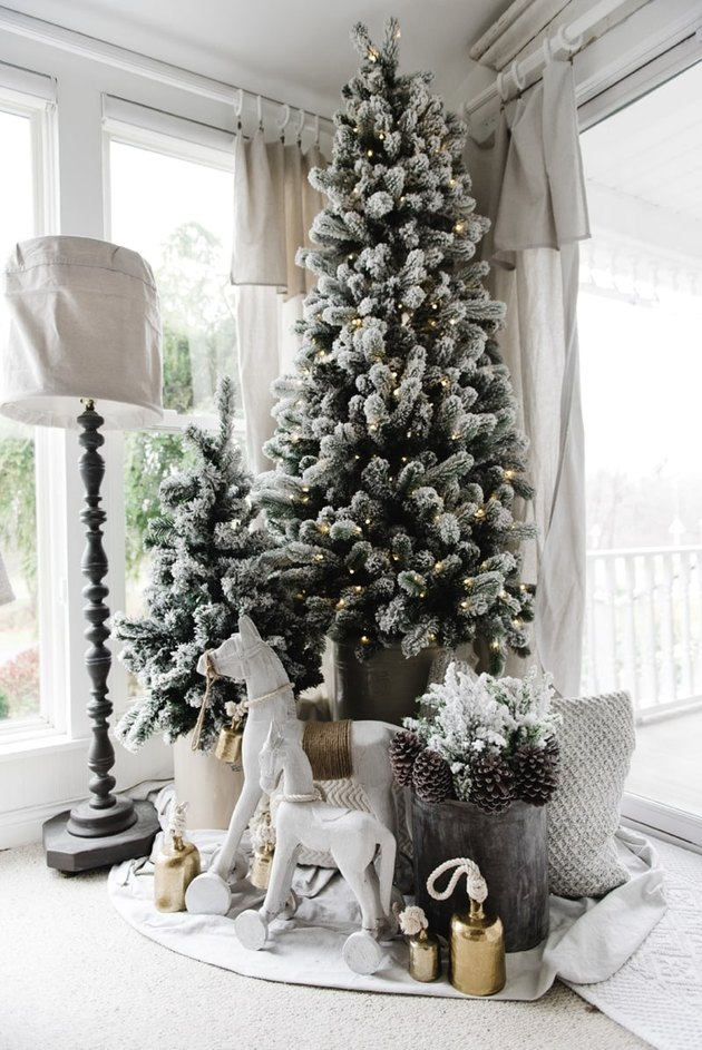 Farmhouse Christmas tree idea with two trees in corner near windows