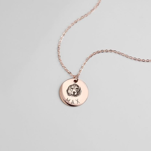 necklace with text reading max and portrait of a dog