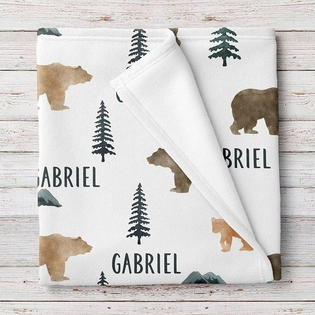 blanket with the name gabriel and bear and trees