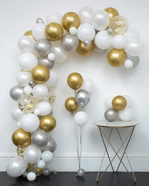 white, gold, and silver balloon arch
