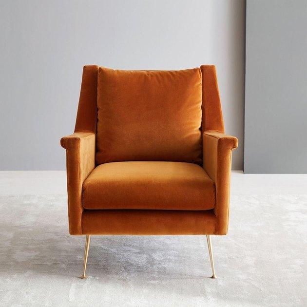 orange velvet midcentury lounge chair from West Elm