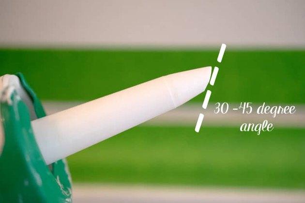 Cut a caulk tube tip.