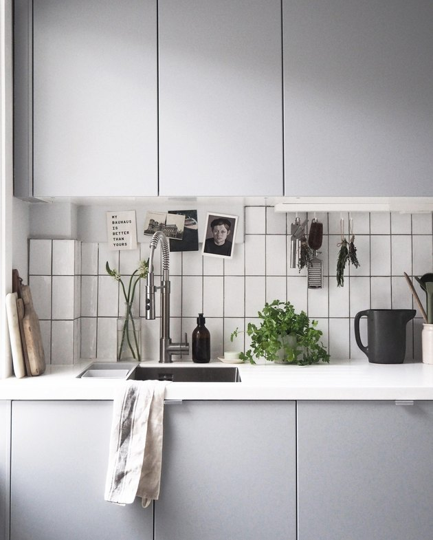 light gray cabinets in minimalist kitchen with single bowl sink