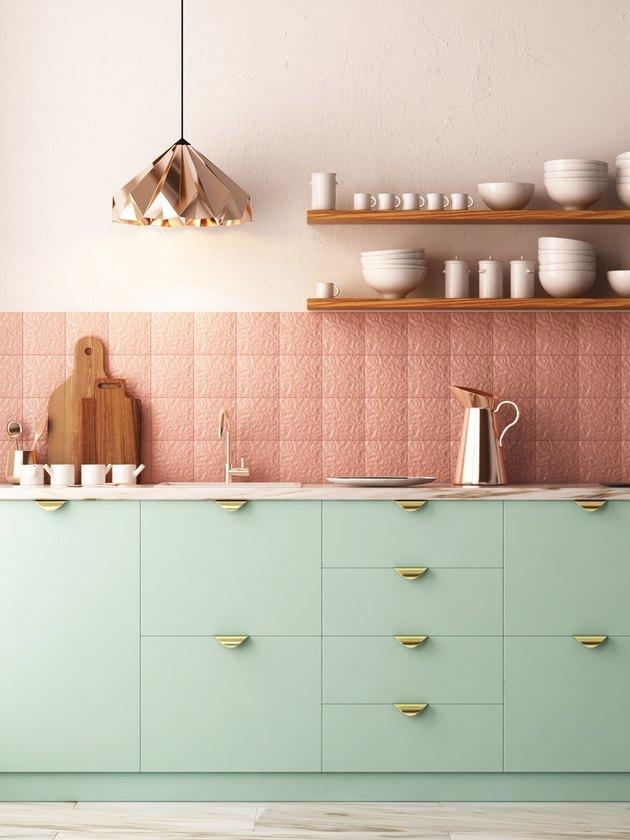 mint green kitchen with copper backsplash and pendant light